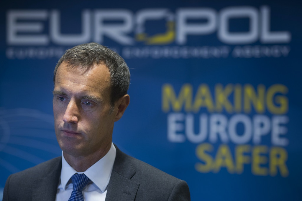 In this Jan. 16, 2015 file photo, the head of the European Union's police agency Europol, Rob Wainwright, answers questions during an interview in The Hague, Netherlands. The European Union's police agency is calling for better awareness and tougher, targeted legislation to tackle cybercrime in the wake of devastating malware and ransomware attacks in recent months. (AP Photo/Peter Dejong, File)