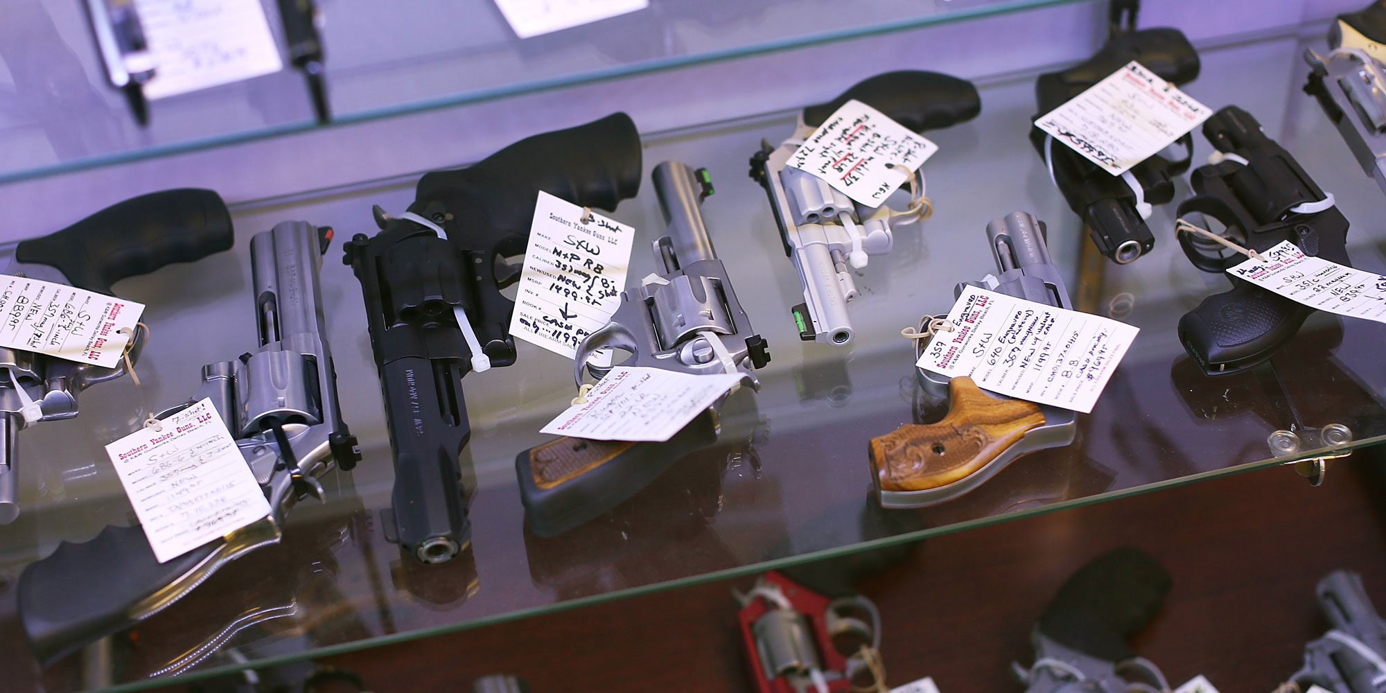 DELRAY BEACH FL- JANUARY 05 Handguns are seen on display at the K&W Gunworks store on the day that U.S. President Barack Obama in Washington DC announced his executive action on guns