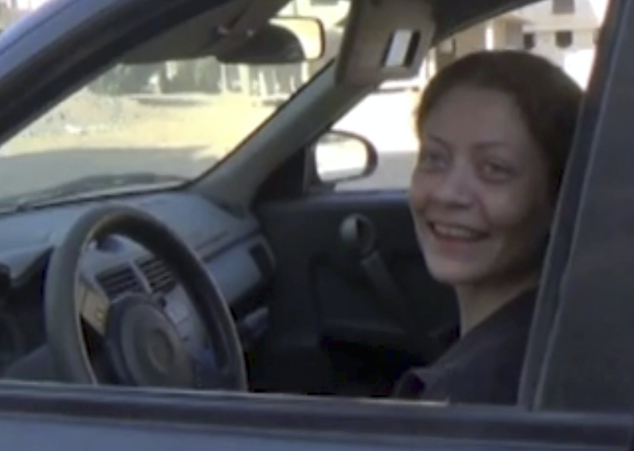 This undated frame grab from video, shows Syrian activist Razan Zaitouneh as she sits inside a car, in Syria. The fate of activist Razan Zaitouneh is one of the longest-running mysteries of Syria's civil war. There's been no sign of life, no proof of death since gunmen abducted her and three of her colleagues from her offices in the rebel-held town of Douma in 2013 -- but clues have emerged that may bring answers. (AP Photo)