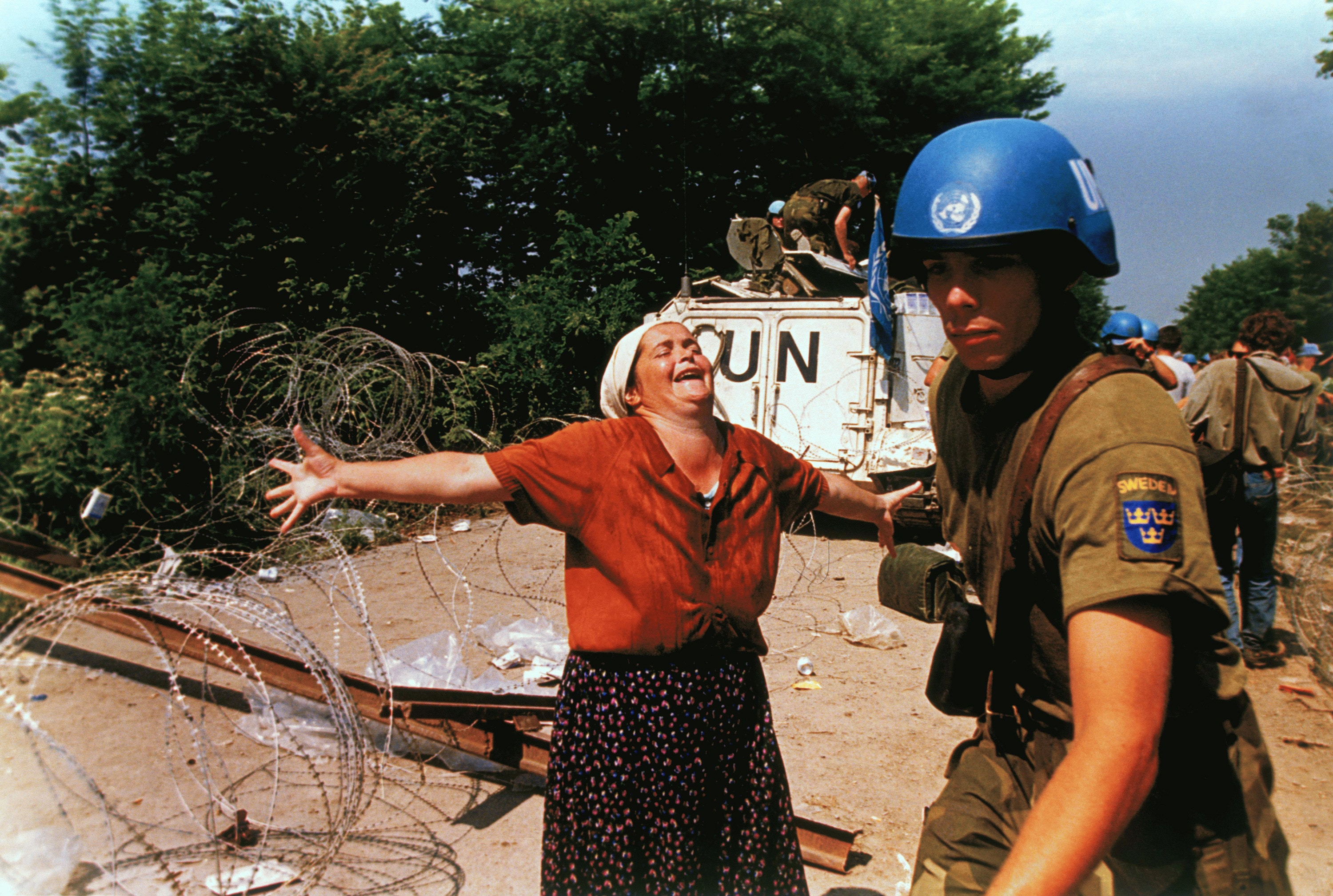 Nedžiba Salihovi?, a woman from Srebrenica, Yugoslavia screams at a United Nations soldier in a refugee camp in Tuzla, Bosnia, July 17, 1995. Over 7,000 men were executed as the United Nations Safe Haven in Srebrenica was overrun by Serb forces, and thousands of bodies were found in mass graves around Srebrenica and still have not been identified.