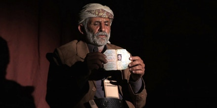 Abdullah Muhammad al-Tisi of Yakla holds a photo of his son Ali Abdullah Mohammed al-Tisi, who was killed in a US drone strike outside Rad`a, Yemen on December 12, 2013. © 2013 Human Rights Watch