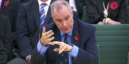 A secret memo suggests GCHQ's Sir Iain Lobban (pictured) wanted more access to the NSA's PRISM data. PA Wire/AP