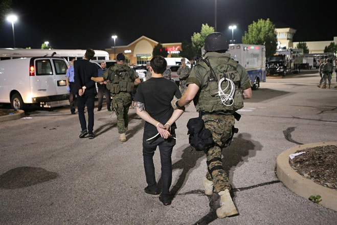 The author being transferred to a police van at the Ferguson command center early this morning. Photo: David Carson/St Louis Post Dispatch/Polaris