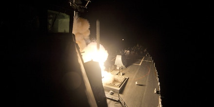 RED SEA - SEPTEMBER 23:  (EDITORS NOTE: IMAGE RELEASED BY U.S. MILITARY PRIOR TO TRANSMISSION) In this handout image provided by the U.S. Navy, The guided-missile destroyer USS Arleigh Burke (DDG 51) launches Tomahawk cruise missiles on September 23, 2014 in the Red Sea. (Photo by Mass Communication Specialist 2nd Class Carlos M. Vazquez II/U.S. Navy via Getty Images)