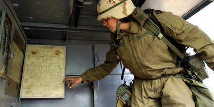 BAIJI, IRAQ - APRIL 28: U.S. Army First Lt. Valerie Phipps, 27, of Sherwood, Arkansas points out chemical charts inside a mobile laboratory April 28, 2003 in the outskirts of Baiji in northern Iraq. Preliminary tests done the previous day on the first of about a dozen 55 gallon drums found at the site show that Sarin and mustard gas may be stored inside them. Samples taken from the barrels by a U.S. Army division team will provide more conclusive results available within 24 to 72 hours. (Photo by Marco Di Lauro/Getty Images)