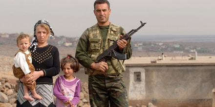 YORUK, TURKEY - OCTOBER 20: Kurdish village guard Bahri Eren (R) and his family protect their village of Yoruk against PKK attacks on civilians near the south-eastern Turkish city of Sirnak, on October 20, 2007 in Yoruk, Turkey. Turkey's parliament voted on October 17 to give its military the green light to hunt members of the Kurdish Workers Party (PKK) in Iraq. Perched on a hillside overlooking the mountainous northern Iraqi border, Kurds in the southeastern Turkish city of Yoruk are nervously monitoring preparations for a possible cross-border military operation. Iraq anticipates only limited Turkish air strikes on Kurdish separatists in the north of the country and wants the guerrillas to leave as soon as possible, Foreign Minister Hoshiyar Zebari said on Thursday. (Photo by Burak Kara/Getty Images)