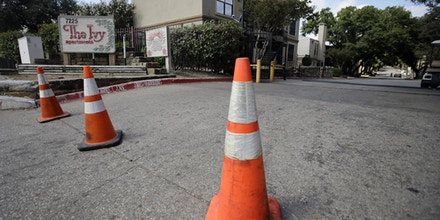 The entrance to The Ivy Apartments is lines with orange cones, Wednesday, Oct. 1, 2014, in Dallas. The man diagnosed with having the Ebola virus was staying at the complex with family. (AP Photo/Tony Gutierrez)
