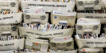 Stacks of boxes holding cards and letters are seen at the U.S. Post Office sort center December 15, 2008 in San Francisco, California. On its busiest day of the year, the U.S. Postal Service is expecting to process and mail over one billion cards, letters and packages. (Photo by Justin Sullivan/Getty Images)