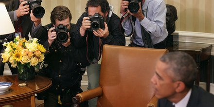 President Barack Obama and photographers
