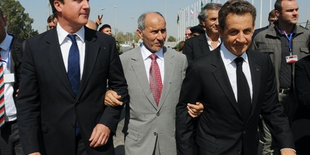 Prime Minister David Cameron and French President Nicholas Sarkozy meet NTC Chairman Mustafa Abdul Jalil  at the Tripoli Medical Centre in Tripoli, Libya. PRESS ASSOCIATION Photo. Picture date: Thursday September 15, 2011. Mr Cameron is making his first visit to Libya today - just weeks after the fall of dictator Muammar Gaddafi. He was being joined by French president Nicolas Sarkozy for talks with leaders of the uprising which seized the Libyan capital on August 23. They are the first leaders from countries which took part in this year's Nato-led military operations in Libya to visit the north African state. See PA story POLITICS Libya. Photo credit should read: Stefan Rousseau/PA Wire