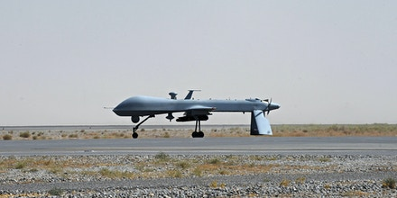 FILE - In this June 13, 2010, file photo a U.S. Predator unmanned drone armed with a missile stands on the tarmac of Kandahar military airport in Afghanistan. Hunting al-Qaida targets from Pakistan to Afghanistan, Yemen to Somalia, the fleet of U.S. armed Predator and Reaper drones that killed two American members of al-Qaida in Yemen Friday, Sept. 30, 2011, are the night stalkers of the expanded U.S. war on terrorists.  (AP Photo/Massoud Hossaini, Pool, File)