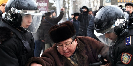 Kazakh riot police officers detain a demonstrator during an opposition rally in Kazakhstan's  commercial capital Almaty, Saturday, Dec. 17, 2011. Speakers at a small meeting in the center of Almaty, demanded that the government set up an investigation commission to explore the precise causes of the violence in Zhanaozen. Authorities in Kazakhstan said Saturday that they have restored order to an oil town rocked by fatal clashes between police and demonstrators. (AP Photo)