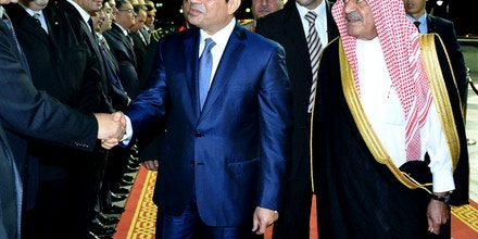 In this Sunday Aug. 10, 2014 photo provided by Saudi Press Agency, Egyptian President Abdel-Fattah el-Sissi, center, shakes hands with officials as Saudi Deputy Crown Prince Muqrin, escorts him, right, upon his arrival to Jiddah, Saudi Arabia. Egypt's President Abdel-Fattah el-Sissi met late Sunday in Saudi Arabia with one of his strongest international supporters, King Abdullah, to talk about key security issues impacting the region. (AP Photo/Saudi Press Agency)