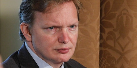 Deputy Chief of Staff Jim Messina listens as President Barack Obama makes a statement to reporters after meeting with his staff and Cabinet members in the Cabinet Room at the White House in Washington, Thursday, Nov. 4, 2010. (AP Photo/Charles Dharapak)