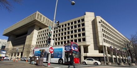 The Federal Bureau of Investigation (FBI) headquarters in Washington Friday, Feb. 3, 2012. They trade jokes, chuckle and talk shop about a hacker plot called