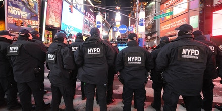 NEW YORK, NY - DECEMBER 31:  Members of the New York City Police Department  attend New Year's Eve 2013 With Carson Daly in Times Square on December 31, 2013 in New York City.  (Photo by Brad Barket/Getty Images)
