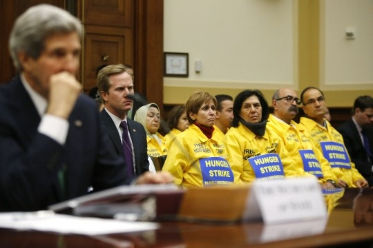 Image #: 25956883    The U.S. families of Iranian dissidents, members of Iran's opposition movement Mujahedin-e Khalq (MEK) who reside in Camp Liberty in Iraq, look on as U.S. Secretary of State John Kerry testifies on agreements over Iran's nuclear programs, before the House Foreign Affairs Committee on Capitol Hill in Washington, December 10, 2013. REUTERS/Jonathan Ernst    (UNITED STATES - Tags: POLITICS MILITARY)       REUTERS /JONATHAN ERNST /LANDOV