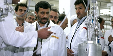 FILE - In this Tuesday, April 8, 2008 file photo released by the Iranian President's Office, Iranian President Mahmoud Ahmadinejad, center, listens to a technician during his visit of the  Natanz Uranium Enrichment Facility some 200 miles (322 kilometers) south of the capital Tehran, Iran. The head of Iran's atomic agency Ali Akbar Salehi said Tuesday, Feb. 9, 2010 that Iran, which is set to start enriching uranium to 20 percent on Tuesday, would not enrich uranium to a higher level if the West provides the fuel it needs for the Tehran research reactor. (AP Photo/Iranian Presidents office, File)