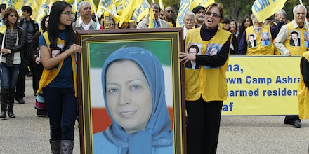 Demonstrators chant as they carry a photo of Iranian opposition leader Maryam Rajavi during a march in Washington after rallying in front of the White House Saturday, Oct. 22,  2011. Hundreds of people rallied, demanding that an Iranian opposition group, Mujahedin-e Khalq (MEK), once allied with Iraq's Saddam Hussein, be removed from a U.S. terror list.  (AP Photo/Jose Luis Magana)