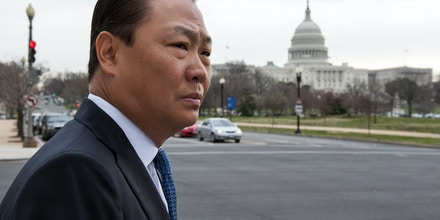With the Capitol in the background, Stephen Kim, a former State Department expert on North Korea, leaves federal court in Washington, Wednesday, April 2, 2014, after a federal judge sentenced him to 13 months in prison for passing classified information to a journalist.  (AP Photo/Cliff Owen)