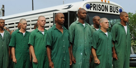 Prisoners from the Elayn Hunt Correctional Center line up as they prepare to undertake a training exercise to learn how to cleanse oil from birds affected by the oil slick from the BP Deepwater Horizon platform disaster in New Orleans Louisiana, on May 3, 2010. Using remote-controlled submarines to shut off the leaking oil well in the Gulf of Mexico is like doing