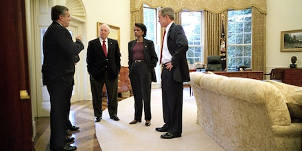 President George W. Bush meets with Vice President Dick Cheney, CIA Director George Tenet and National Security Advisor Condoleezza Rice in the Oval Office after informing the nation that air strikes were made against the Taliban Sunday, October 7, 2001WHITE HOUSE PHOTO BY ERIC DRAPER