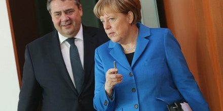 BERLIN, GERMANY - MARCH 04:  German Chancellor Angela Merkel and Vice Chancellor and Economy and Energy Minister Sigmar Gabriel arrive for the weekly German government cabinet meeting on March 4, 2015 in Berlin, Germany. High on the mroning's agenda was the German military's continued participation in the EU-led EUTM training mission in Somalia.  (Photo by Sean Gallup/Getty Images)