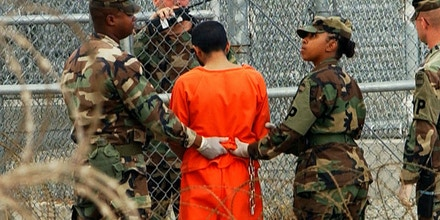 400671 01: A detainee is taken from a questioning session at camp X-Ray February 6, 2002 in Guantanamo Bay, Cuba. The 156 Al Qaeda and Taliban prisoners are questioned frequently, and are always transported to and from these sessions manacled. (Photo by Chris Hondros/Getty Images)