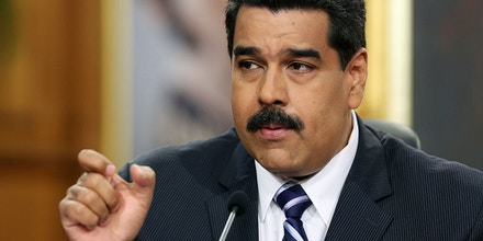 Venezuela's President Nicolas Maduro speaks during a press conference at Miraflores Presidential Palace in Caracas, Venezuela, Tuesday, Dec. 30, 2014. Venezuela's socialist government Tuesday confirmed the economy fell into a deep recession this year but blamed the slump on opponents trying to sabotage activity in the oil-rich nation. (AP Photo/Ariana Cubillos)