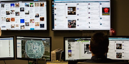 Employees monitor social media sites in the back offices of the Mall of America on Monday, Feb. 23, 2015 in Bloomington, Minn.  The monitoring is for marketing and security reasons. Shoppers at the Mall of America seem undeterred after hearing about a video purportedly made by al-Qaida-linked rebels that urges Muslims to attack shopping malls. The video specifically mentions the Bloomington shopping mall. (AP Photo/The Star Tribune, Renee Jones Schneider)