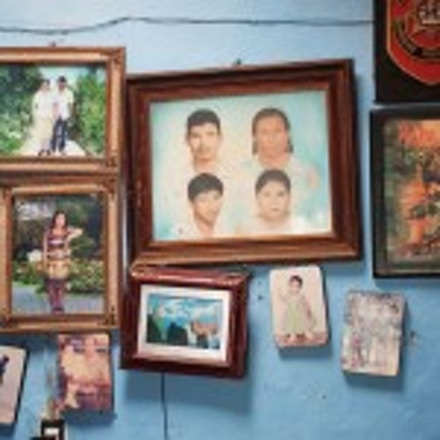 Forty-three male students from the Raul Burgos Rural Teachers College in Ayotzinapa, Guerrero were disappeared on September 26, 2014 at the hands of local police working in conjunction with drug traffickers. Family photos hang on the livivng room wall in the house of Jhosivani Guerrero de la Cruz, one of the 43 missing normal school students, in Omeapa, Guerrero. (Keith Dannemiller)