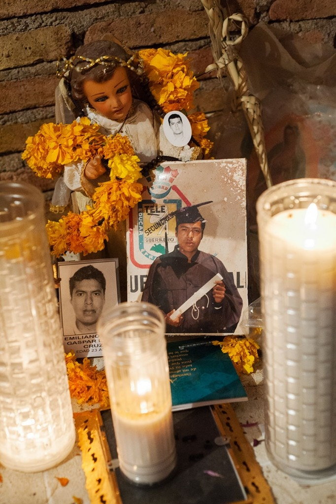Forty-three male students from the Raul Burgos Rural Teachers College in Ayotzinapa, Guerrero were disappeared on September 26, 2014 at the hands of local police working in conjunction with drug traffickers. A small altar with Day of the Dead flowers, candles and photos of Emiliano Alan Gaspar de la Cruz, one of the disappeared students, sits in a corner of the family's house in Omeapa, Guerrero.