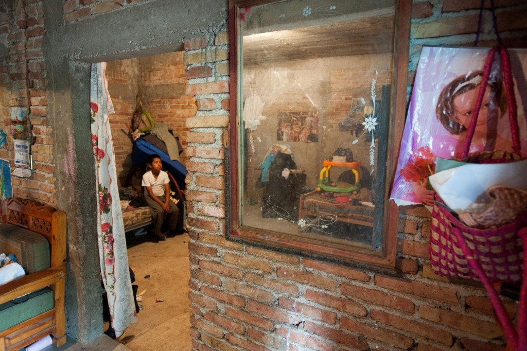 Forty-three male students from the Raul Burgos Rural Teachers College in Ayotzinapa, Guerrero were disappeared on September 26, 2014 at the hands of local police working in conjunction with members of a criminal gang. Views of the interior of the home of Emiliano Alan Gaspar de la Cruz in Omeapa, Guerrero. His younger brother Brian Gaspar de la Cruz sits on a bed tha Emiliano slept in when he was sick and needed the care of his parents.