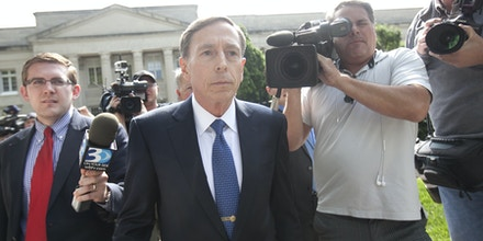 CHARLOTTE, NC  - APRIL 23:  Former director of CIA and former commander of U.S. Forces in Afghanistan Gen. David Petraeus exits the federal courthouse after facing criminal sentencing on April 23, 2015 in Charlotte, North Carolina.   Petraeus faced criminal sentencing for giving classified information to his former mistress and biographer.  (Photo by John W. Adkisson/Getty Images)
