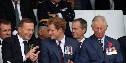 Britain's Prince of Wales, right, his son, Prince Harry, center, and Australia's Prime Minister, Tony Abbott, applaud during a ceremony at the 57th Turkish Regiment cemetery and memorial site at the Gallipoli peninsula, Turkey, Saturday, April 25, 2015.  As world leaders gather with the descendants of the fighters in Gallipoli, the memories of one of the most harrowing campaigns of the 20th century have come surging back to life. The doomed Allied offensive to secure a naval route from the Mediterranean to Istanbul through the Dardanelles, and take the Ottomans out of the war, resulted in over 130,000 deaths on both sides.(AP Photo/Burhan Ozbilici)