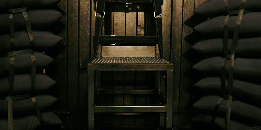 Bullet holes are visible in the wood panel behind the chair  in the execution chamber at the Utah State Prison after Ronnie Lee Gardner was executed by firing squad Friday, June 18, 2010 in Draper Utah.. Gardner was convicted of aggravated murder in 1985.(AP Photo/Trent Nelson/Pool)