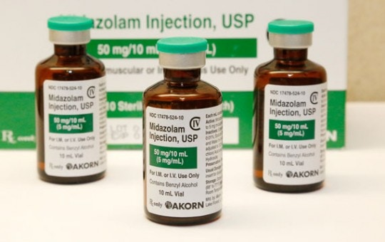 FILE - This July 25, 2014 file photo shows bottles of the sedative midazolam at a hospital pharmacy in Oklahoma City. Oklahoma plans to resume executions Thursday, Jan. 15, 2015, after botching its last one and will use the same three-drug method as a Florida lethal injection scheduled for the same day. The drug mixture begins with the sedative midazolam and includes the same drugs used in Oklahoma's botched execution of Clayton Lockett, who writhed on the gurney and moaned after he'd been declared unconscious. (AP Photo/File)