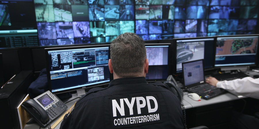 NEW YORK, NY - APRIL 23:  Police and private security personel monitor security cameras at the Lower Manhattan Security Initiative on April 23, 2013 in New York City. At the counter-terrorism center, police and private security personel monitor more than 4,000 surveillance cameras and license plate readers mounted around the Financial District and surrounding parts of Lower Manhattan. Designed to identify potential threats it is modeled after London's