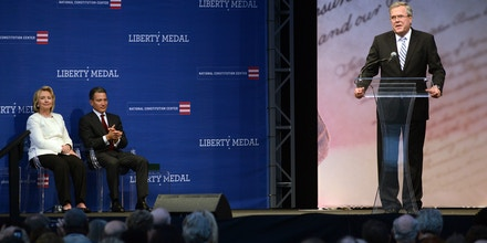 PHILADELPHIA, PA -  SEPTEMBER 10:  Former Secretary of State Hillary Rodham Clinton and Jeffrey Rosen, president and CEO of the National Constitution Center, listen as former Florida Gov. Jeb Bush speaks before the presentation of the 2013 Liberty Medal September 10, 2013 in Philadelphia, Pennsylvania. The Liberty Medal was established in 1988 to commemorate the bicentennial of the U.S. Constitution. Given annually, the medal aims to recognize leadership in the pursuit of freedom.  (Photo by William Thomas Cain/Getty Images)