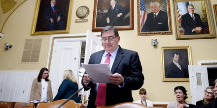 WASHINGTON, DC - FEBRUARY 2: U.S. Rep. Michael C. Burgess (R-TX) reads before a House Rules Committee meeting February 2, 2015 on Capitol Hill in Washington, DC. The committee meets to formulate a rule on H.R.596, to repeal the Patient Protection and Affordable Care Act and health care-related provisions in the Health Care and Education Reconciliation Act of 2010.(Photo by Oliver Douliery/Getty Images)