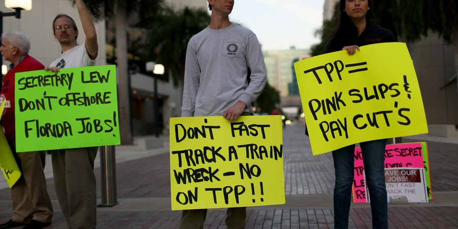 MIAMI, FL - MARCH 20:  Union members and community activists protest outside the Miami Dade College where the Greater Miami Chamber of Commerce and the college were hosting a moderated conversation with U.S. Secretary of the Treasury Jacob Lew on March 20, 2015 in Miami, Florida. The protesters are against the Trans-Pacific Partnership (TPP) which is a proposed twelve-nation pact and are asking the Federal Government and Florida Congressional delegation to reject fast tracking the TPP and warn that the deal poses serious risk to jobs and wages, the environment, food safety and public health for Floridas working families.  (Photo by Joe Raedle/Getty Images)