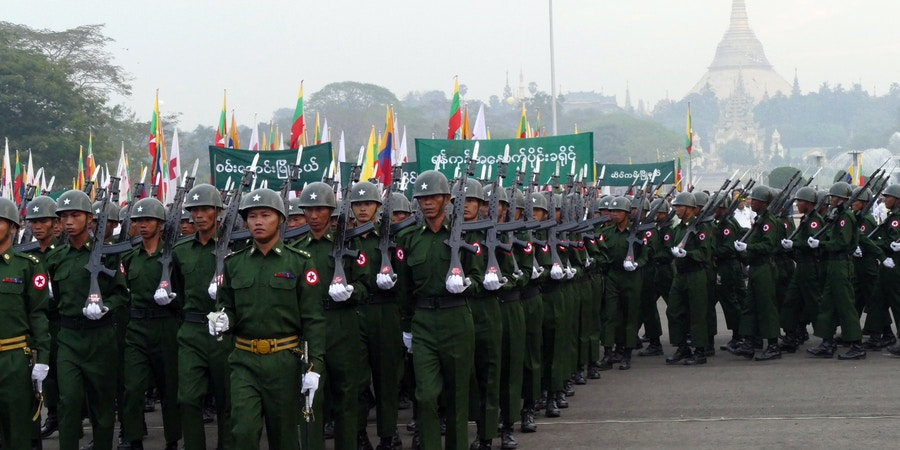 Myanmar soldiers march during a ceremony to mark the 68th anniversary of Union Day at public square in Yangon, Myanmar Thursday, Feb. 12, 2015. Union Day, is held annually to mark the anniversary of a 1947 agreement among the country's ethnic groups that paved the way to independence from Britain.(AP Photo/Khin Maung Win)