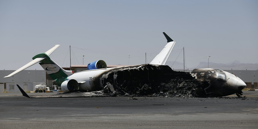A Felix Airways plane, a domestic airline, destroyed by Saudi-led airstrikes, at the Sanaa International airport, in Yemen, Wednesday, April 29, 2015. Saudi-led coalition warplanes pounded Shiite rebels and their allies overnight and throughout the day on Tuesday in the Yemeni capital. Around midday, airstrikes hit Sanaa International airport, setting a plane owned by a private company on fire, according to a statement released by the Shiite rebels, known as Houthis. (AP Photo/Hani Mohammed)