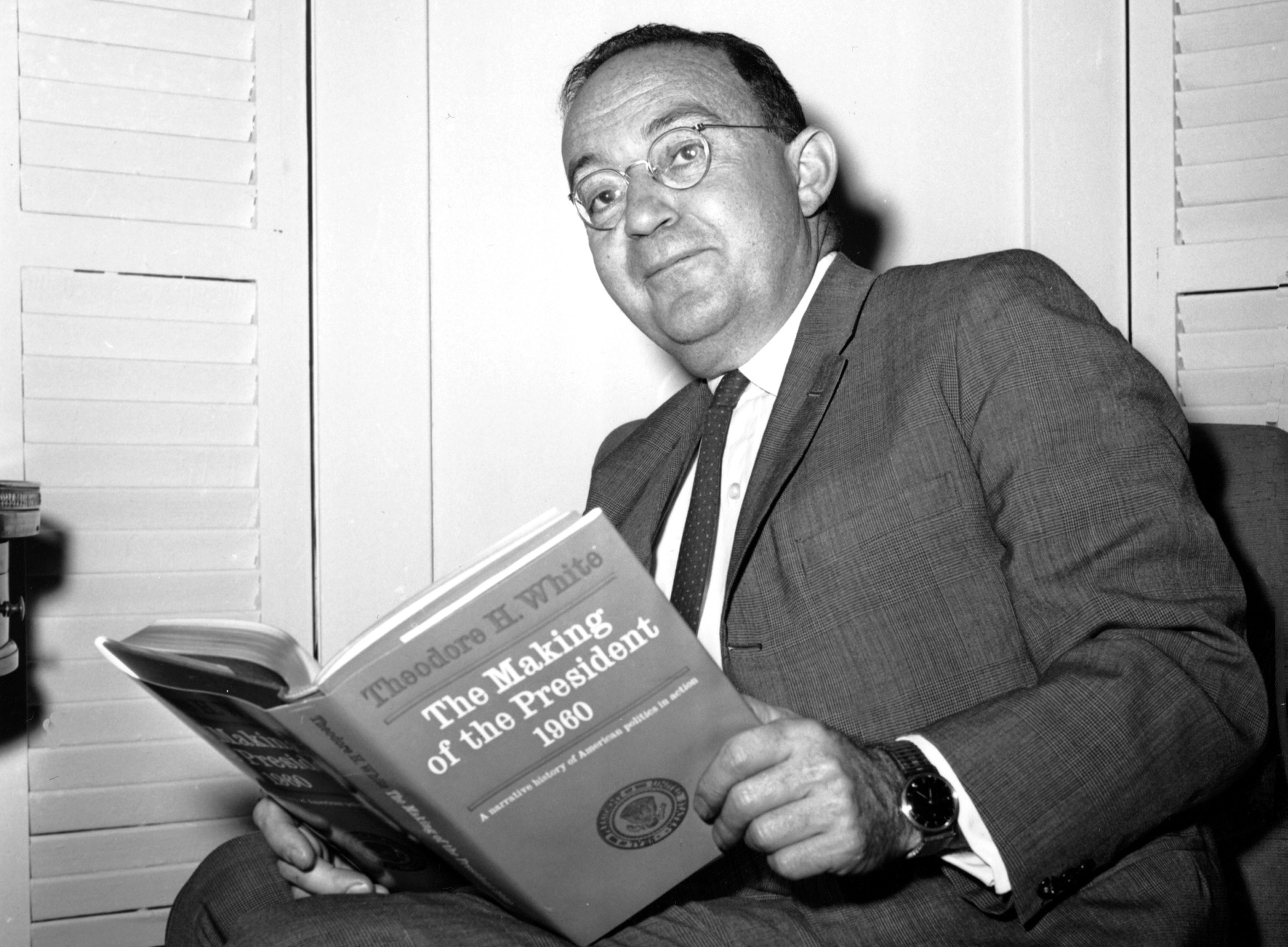 Author Theodore H. White poses in his New York City apartment with the book that won him the Pulitzer Prize on May 7, 1962.  White won for his book