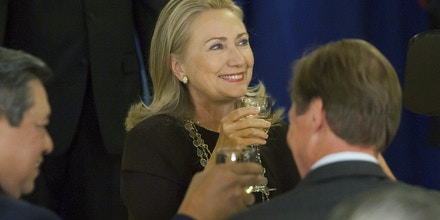 NEW YORK - SEPTEMBER 25:   U.S. Secretary of State Hillary Clinton makes a toast at a luncheon hosted by the Secretary-General in honor of Heads of State and Government at the United Nations during the General Assembly on September 25, 2012 in New York City.  Over 120 prime ministers, presidents and monarchs are gathering this week at the U.N. for the annual meeting. This year's focus among leaders will be the ongoing fighting in Syria, which is beginning to threaten regional stability.  (Photo by Michael Nagle/Getty Images)