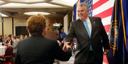 Rep. Pete King R-N.Y. shakes hands with New Hampshire state GOP party Chair Jennifer Horn after speaking at a Republican Leadership Summit, Friday, April 17, 2015, in Nashua, N.H. (AP Photo/Jim Cole)