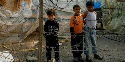 Image #: 36135253    epa04704205 Young Syrian refugees stand around during a vist by the United Nations High Commissioner for Refugees (UNHCR), Antonio Guterres (not pictured), to a camp in the Zahrani area of southern Lebanon, 14 April 2015. Antonio Guterres, accompanied by representatives of donor countries conference from the Kuwaiti summit, visited Syrian refugees in Lebanon, who have now exceeded one million in Lebanon according to UN figures, about a quarter of the total number of Syrians forced to leave Syria due to the ongoing civil war in the country, which has claimed some 2220'000 lives to date.  EPA/STR /LANDOV