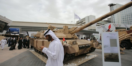 Emirati and other officials visit the International Defence Exhibition and Conference, IDEX, in Abu Dhabi, United Arab Emirates, Sunday, Feb. 22, 2015. (AP Photo/Kamran Jebreili)
