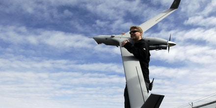 **GOES WITH STORY BY JOAN LOWY**Flight test pilot Alex Gustafson carries an Insitu ScanEagle unmanned aircraft in preparation for a flight in Arlington, Ore., Tuesday, March 26, 2013.(AP Photo/Don Ryan)