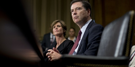 FBI Director James Comey, joined by Deputy Attorney General Sally Quillian Yates, pauses as he testifies during the Senate Judiciary Committee hearing on Capitol Hill in Washington, Wednesday, July 8, 2015.  U.S. federal law enforcement officials pressed their concerns about data encryption before Congress Wednesday, telling senators that the right to privacy is not absolute and must be weighed against public-safety interests.   (AP Photo/Carolyn Kaster)